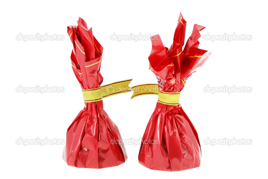 Two candies in the red packaging on a white background — Stock Photo #1259524