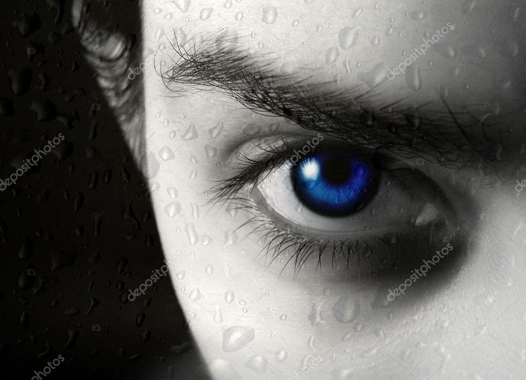 Photo of half of face of the beautiful young blue-eyed girl and drop of a rain on glass — Stock Photo #1100621