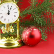 Chrismas still life:boll and gold watch — Stock Photo