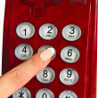 Royalty-Free Stock Photo: Red telephone and finger