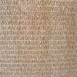 Old text on ancient wall  stone - Stock Photo