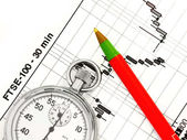 Business chart with stopwatch — Stock Photo