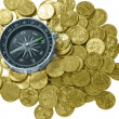 Stock Photo: Compass and coins