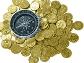 Compass and coins — Stock Photo
