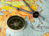 Compass and map — Stockfoto