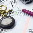 Stock Photo: Finances graph, pen and watch