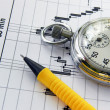 Business diagram and watch-stopwatch - Stock Photo
