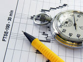 Business diagram and watch-stopwatch — Stock Photo