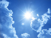 Cloudscape with sun — Stock Photo