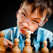 Nerd play chess - Stock Photo