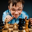 Nerd play chess — 图库照片