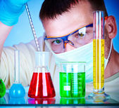 Scientist in laboratory with test tubes — Foto Stock