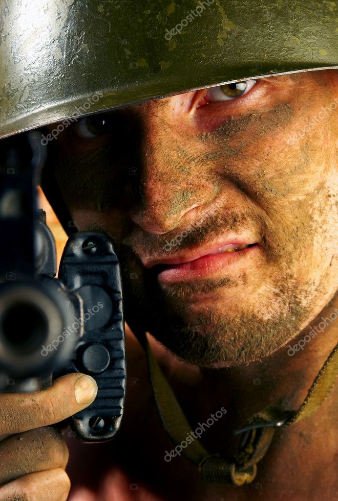 The soldier in a military helmet   Stock Photo #1189222