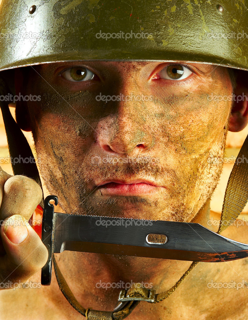 The soldier in a military helmet   Stock Photo #1189233