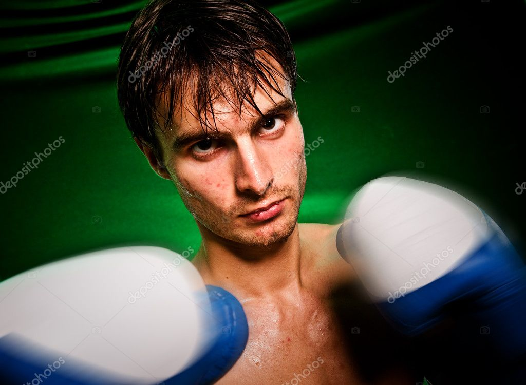 Man sweating all over in boxing gloves...  Stock Photo #1189341