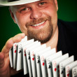 Man skilfully shuffles playing cards — Stock Photo