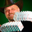 Man skilfully shuffles playing cards — Stock Photo #1190390