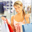 Stock Photo: Girl with bags - comparison shopping. Sa
