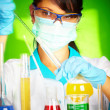 Stock Photo: Scientist in laboratory with test tubes