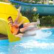 Father with the son on waterslide — Стоковое фото