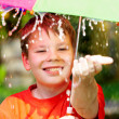 Boy under an umbrella during a rain — Stock Photo