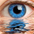 Human eye reflected in a surface of wate - Stock Photo