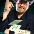 Man with a beard plays poker - Stok fotoraf