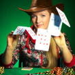 Girl with a beard plays poker - Stock Photo