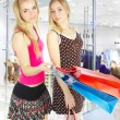 Two girls with bags - comparison shoppin — Stock Photo