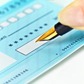 Writing Checks — Stock Photo