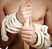 Man with a cord on hands — Stock Photo