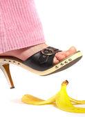 Female leg(foot) and peel of a banana. L — Stok fotoğraf