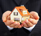 Hand of the businessman with the house — Stock Photo