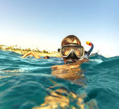 Boy floats in the sea — Stock Photo