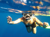 Boy floats under water — Stock Photo