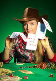 Girl with a beard plays poker — Stock Photo