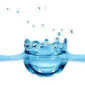 Falling drop of blue water — Stock Photo