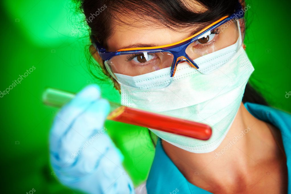 Young scientist in laboratory with test tubes  — Foto de Stock   #1190828
