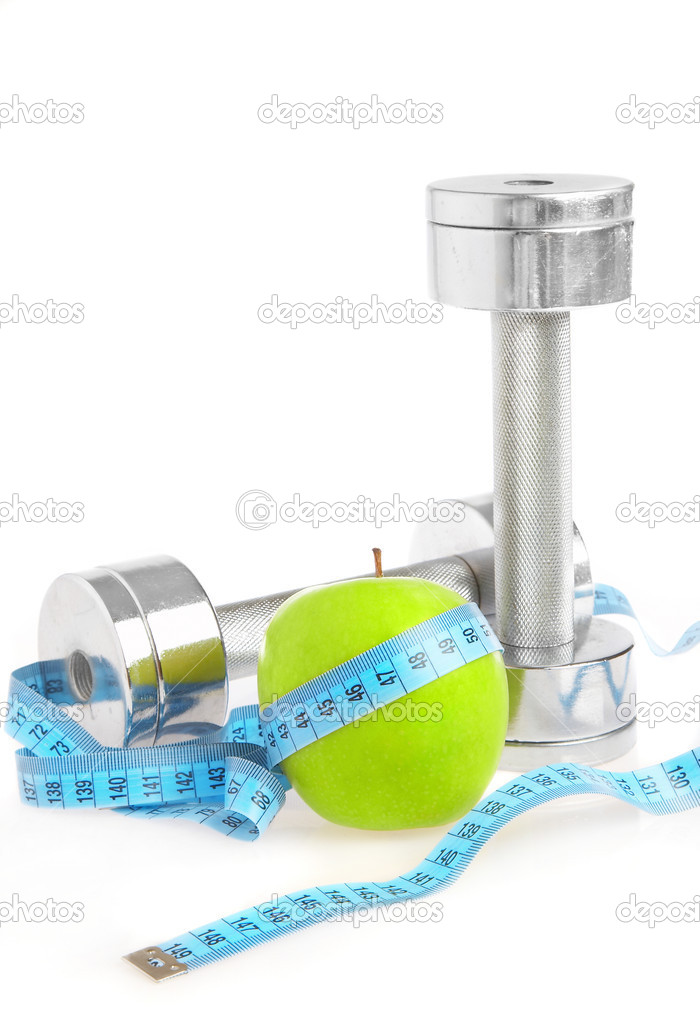 Dumbbells with an apple on a white background. A healthy way of life  Stock Photo #1191093