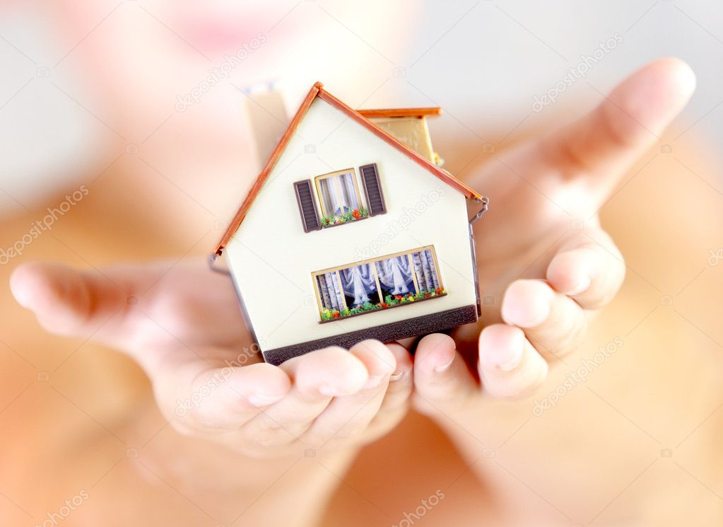 The house in human hands — Stock Photo #1191412