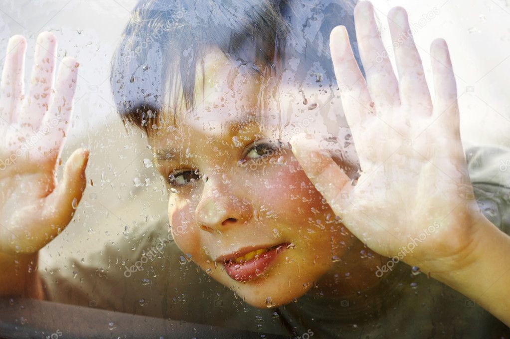 Child and window on a wet rainy day ... — Stock Photo #1191584