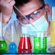 Scientist in laboratory with test tubes — Foto de Stock