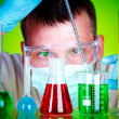 Scientist in laboratory with test tubes — Stockfoto
