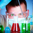 Scientist in laboratory with test tubes — Stock Photo