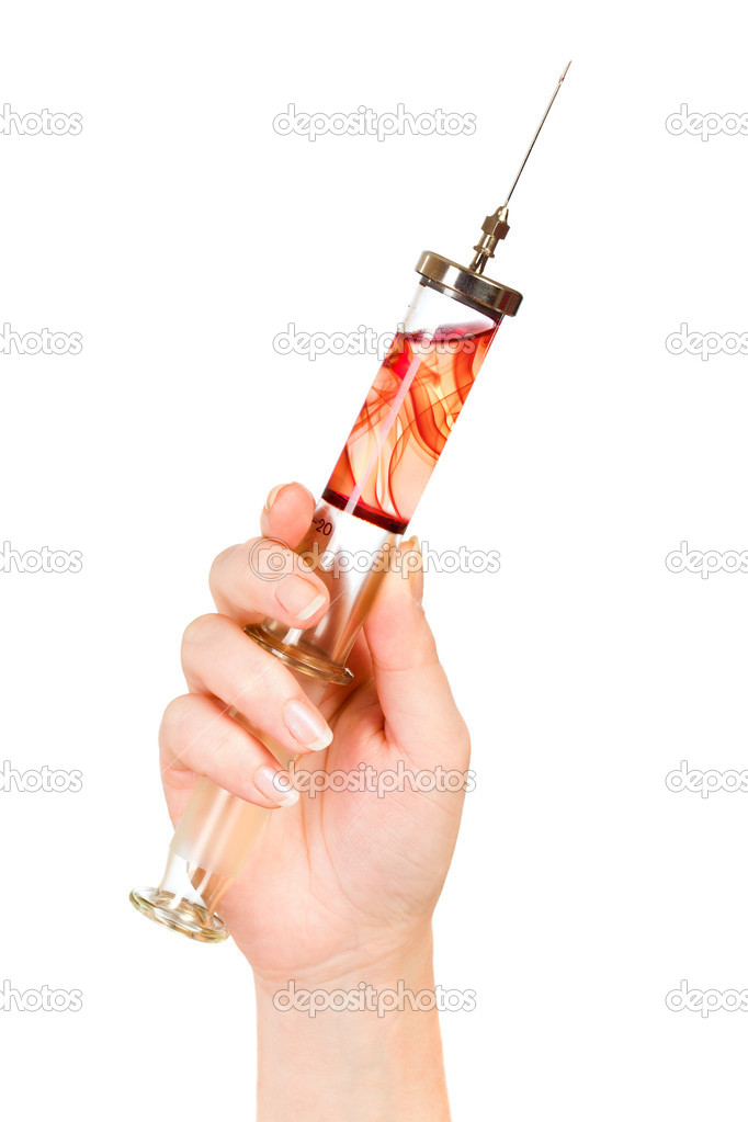 Glass syringe in a hand on the white — Stock Photo #1204009