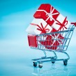 Stock Photo: Shopping cart ahd gift
