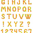 Alphabet from fruit on a white backgroun — Stock Photo