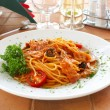 Spaghetti with a tomato sauce on a table - Photo