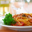 Spaghetti with a tomato sauce on a table — Stock Photo