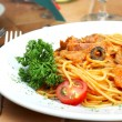 Spaghetti with a tomato sauce on a table - Stock Photo